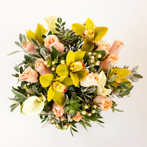 Clarice Bouquet, from above - Cymbibduim heads, orchids, roses, hypericum finished with greenery