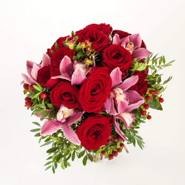 Moody Magic Bouquet from above, Red roses, Hypericum, Cymbidium heads orchids finished with greenery
