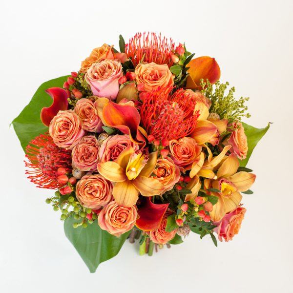 Extravaganza bouquet above, Roses, Cymbidium heads orchids, Zant calla lilies,hypiericum, Leucospermum, finishing baby monstera and greenery